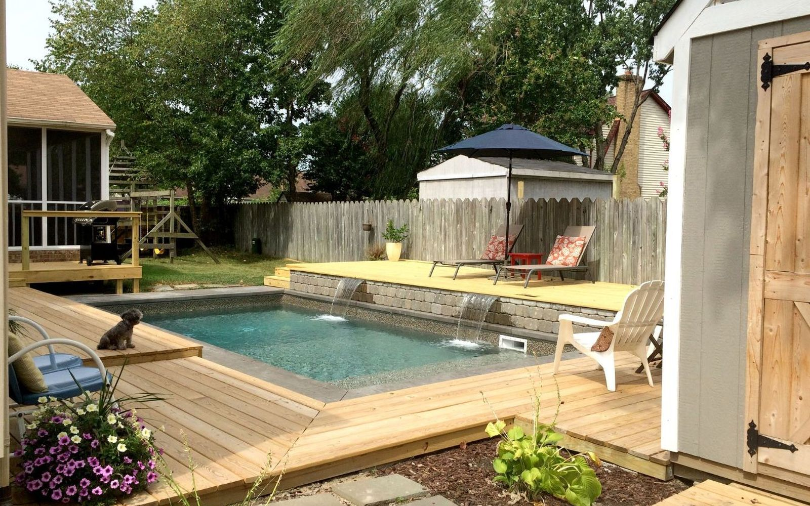 s wow 11 dreamy ideas for people who have backyard pools, outdoor living, pool designs, Add a raised sun bathing platform