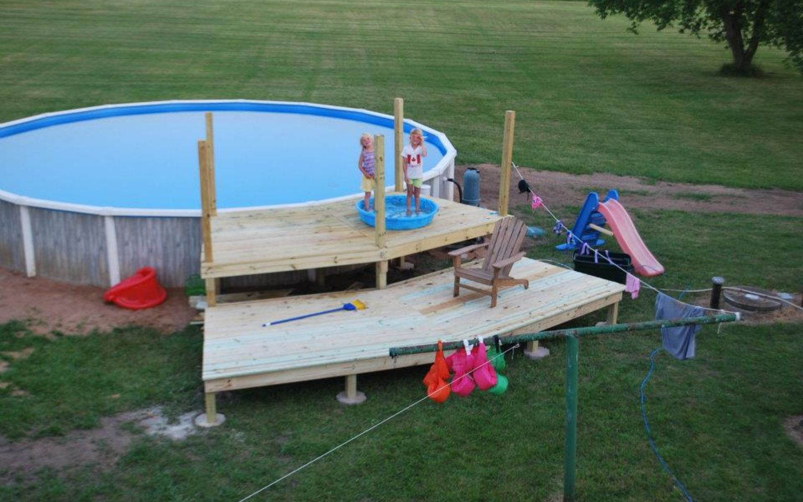s wow 11 dreamy ideas for people who have backyard pools, outdoor living, pool designs, Construct a large platform for play storage