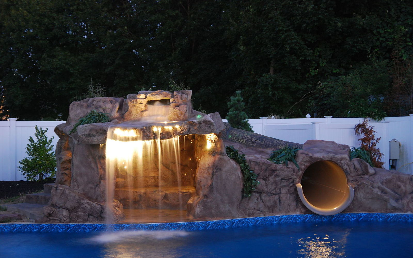 s wow 11 dreamy ideas for people who have backyard pools, outdoor living, pool designs, Commission an awesome slide and grotto