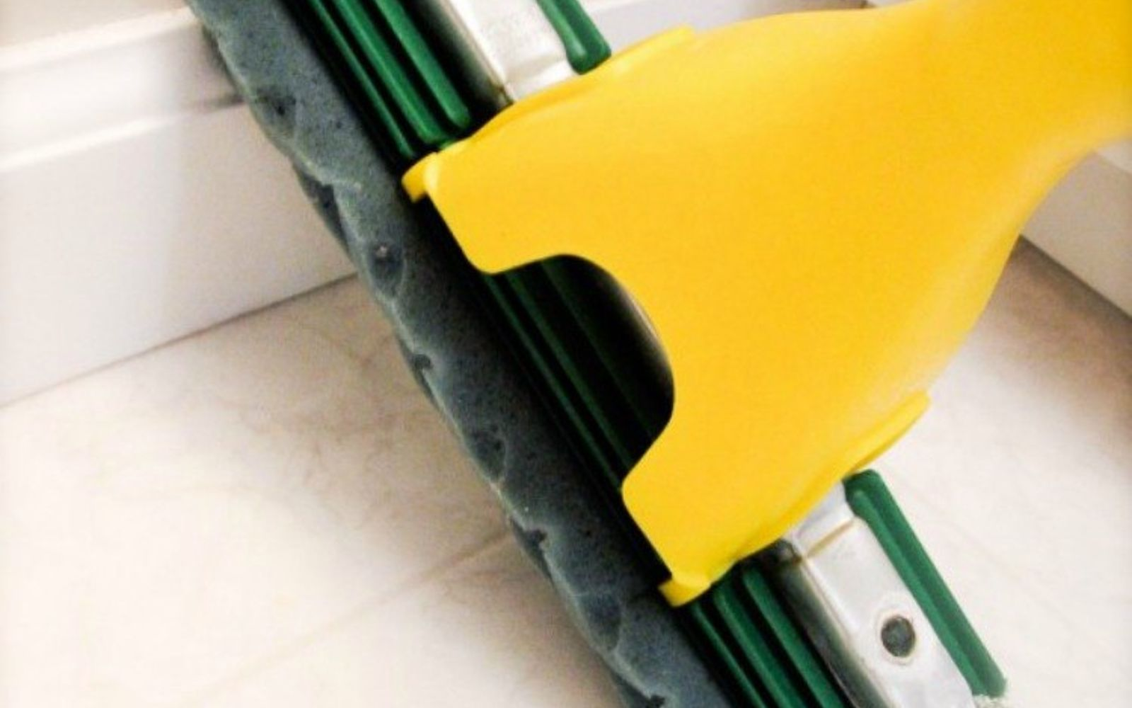 s 12 cleaning tricks that people with spotless living rooms swear by, cleaning tips, entertainment rec rooms, living room ideas, Clean baseboards while cleaning the floor