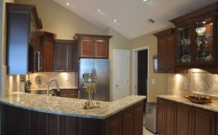 smaller kitchen in a retirement area with a punch , countertops, kitchen cabinets, kitchen design