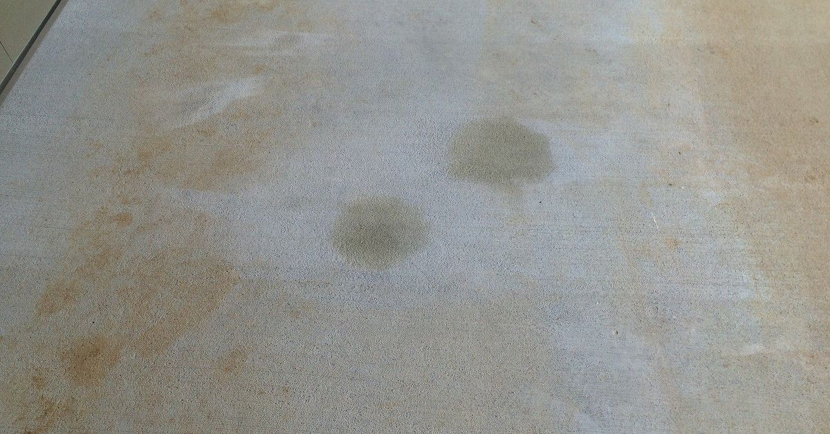 What is the best way to remove oil stains from newly for Cleaning oil off cement