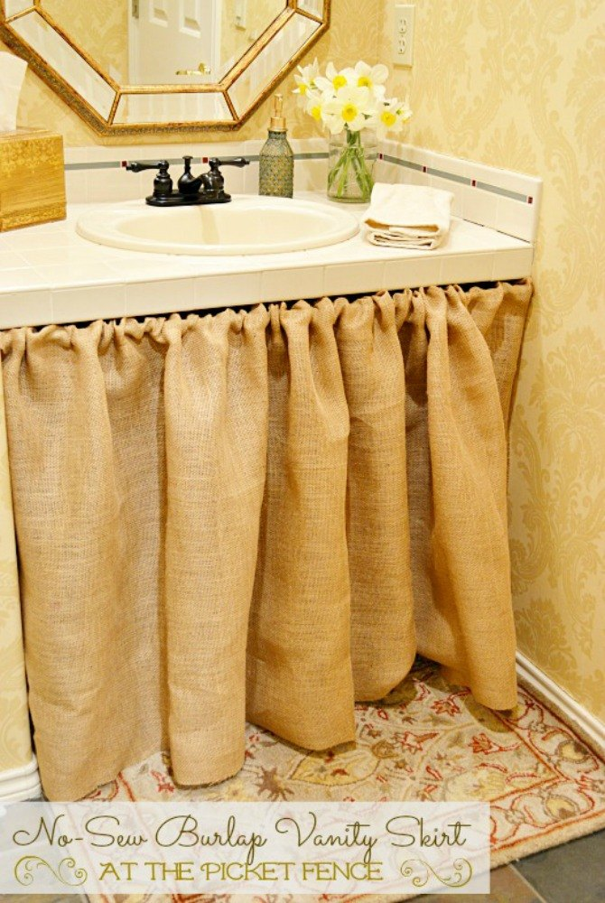Create a skirt to hide the vanity cabinets. 11 Ways to Transform Your Bathroom Vanity Without Replacing It