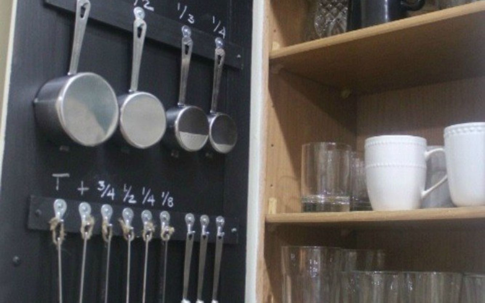 s 12 space saving solutions for your tight kitchen, kitchen design, shelving ideas, Organize measuring cups on your cabinet door