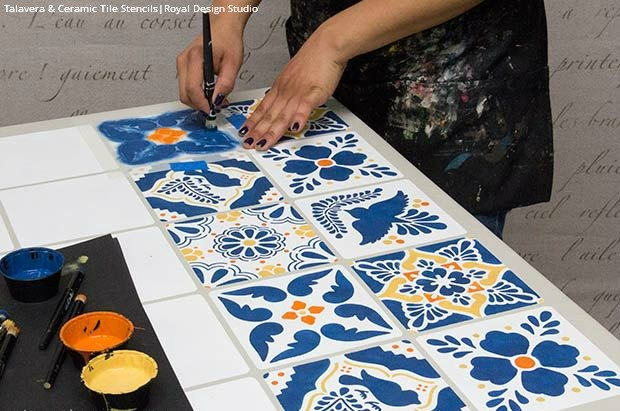 How to stencil a mexican talavera tile table hometalk for How to paint tile floor
