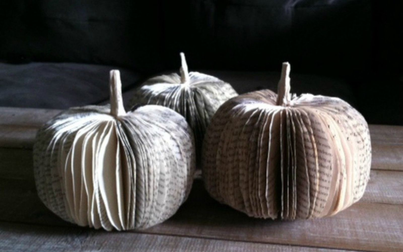 s 13 shocking things you can do with old unwanted books, repurposing upcycling, Cut out a book into cute pumpkins