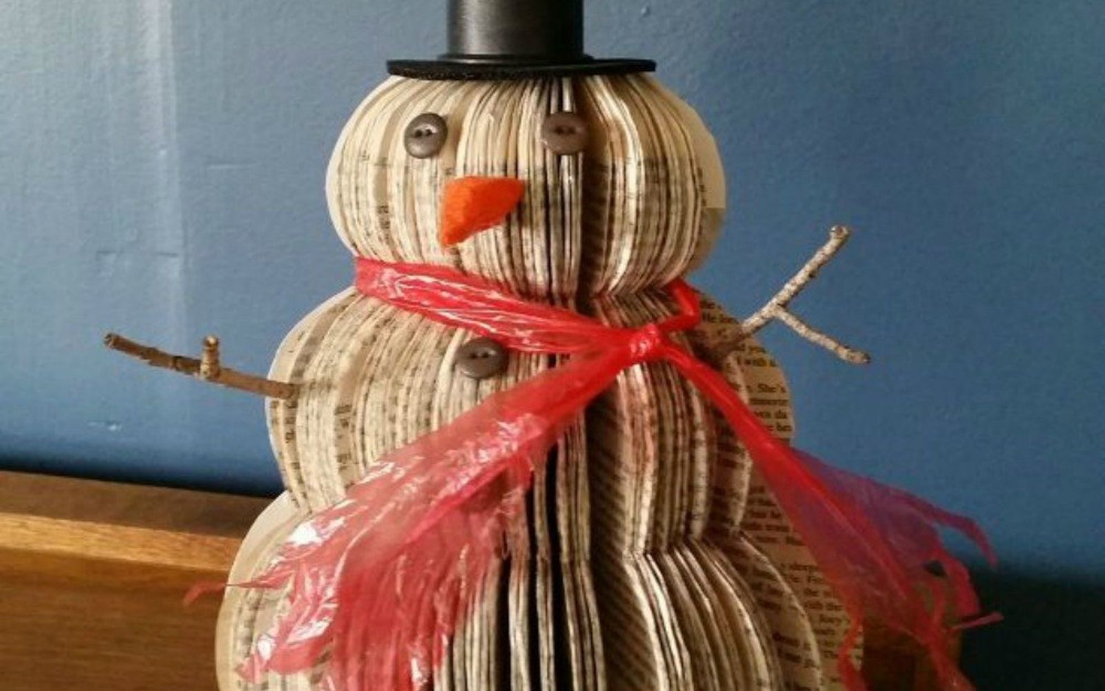 s 13 shocking things you can do with old unwanted books, repurposing upcycling, Cut your book into an adorable snowman