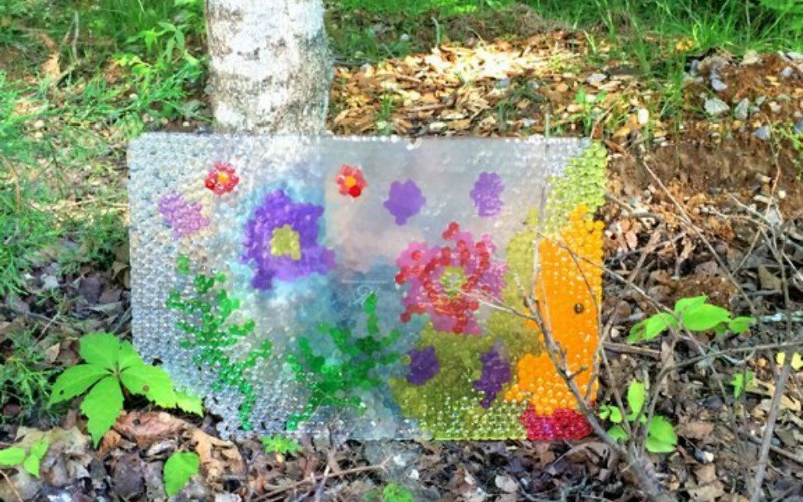 s don t throw out that old cookie sheet before you see these ideas, repurposing upcycling, Melt beads on it for sparkling garden art