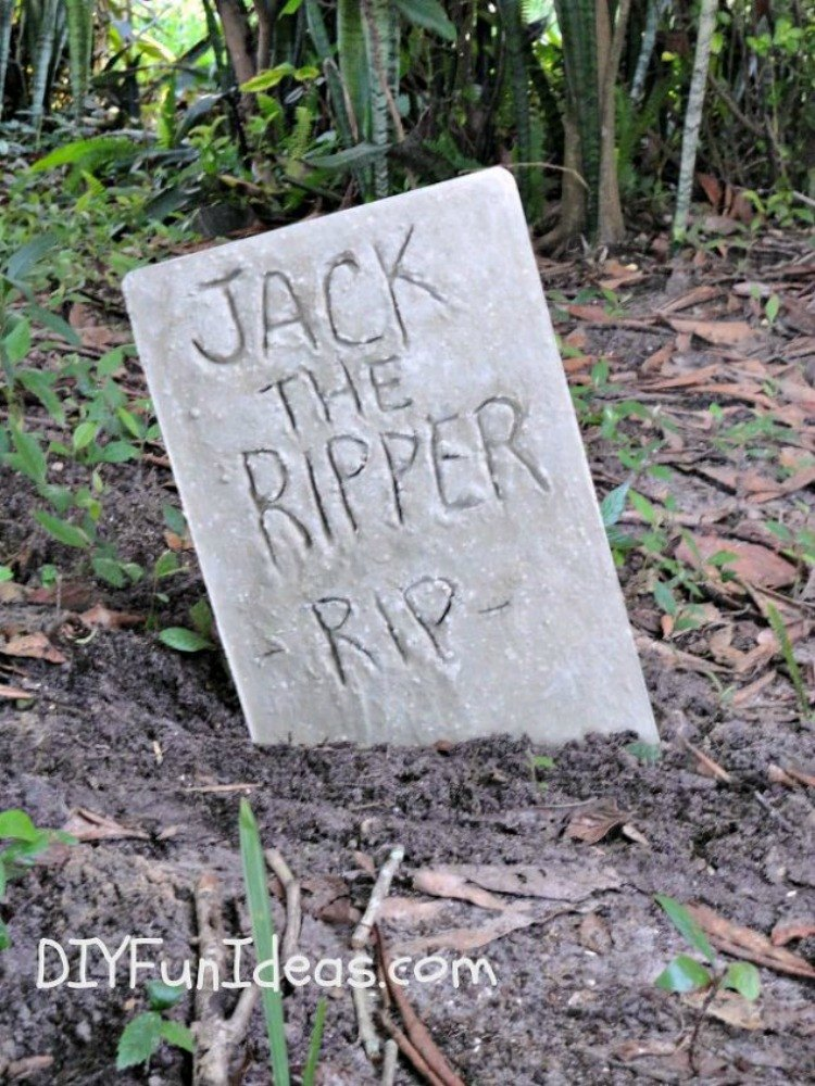 add some fun cement grave stones in your yard - How To Decorate Your Yard For Halloween