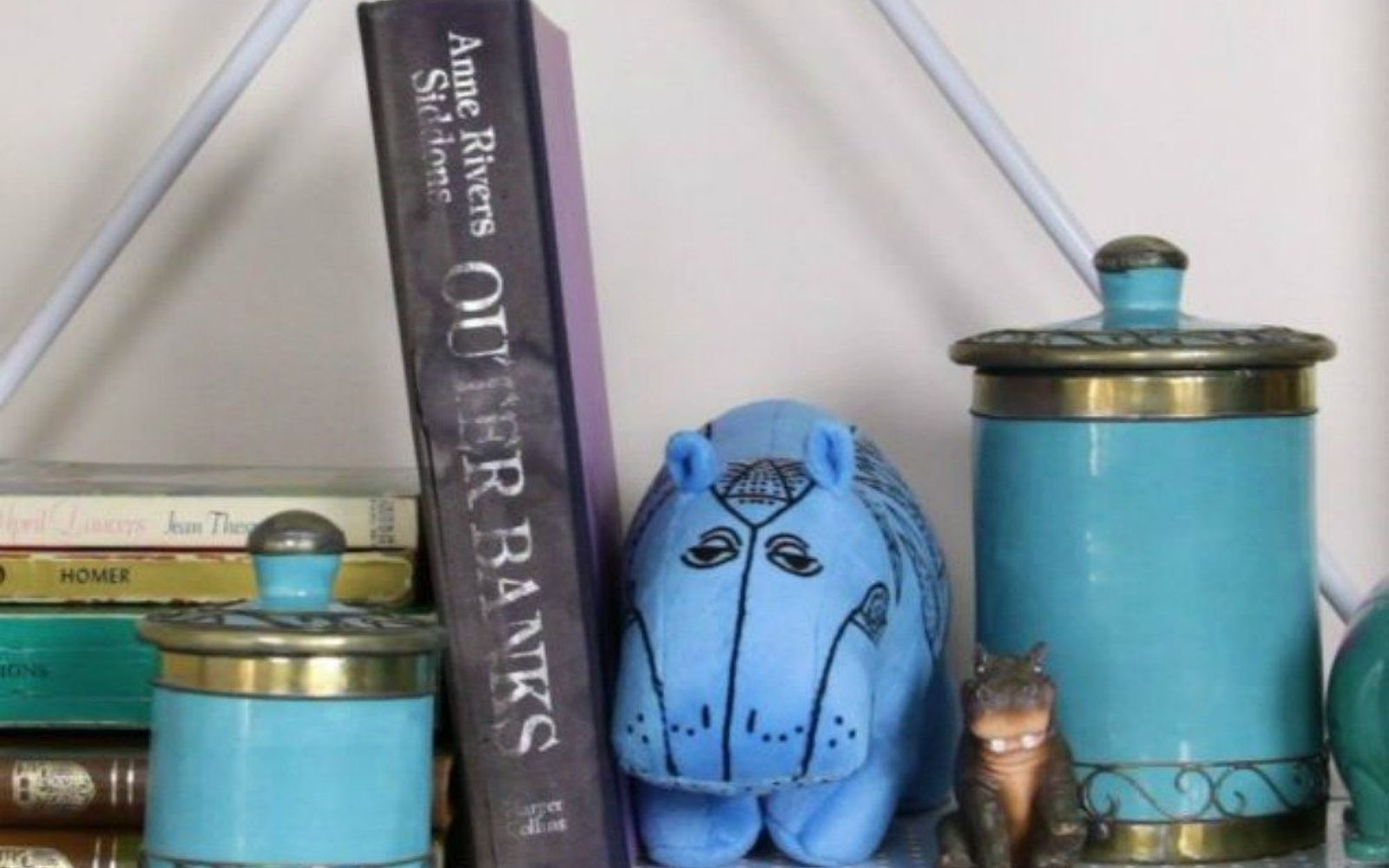 s hide your home s eyesores with these 11 brilliant ideas, home decor, The fix an old book cover