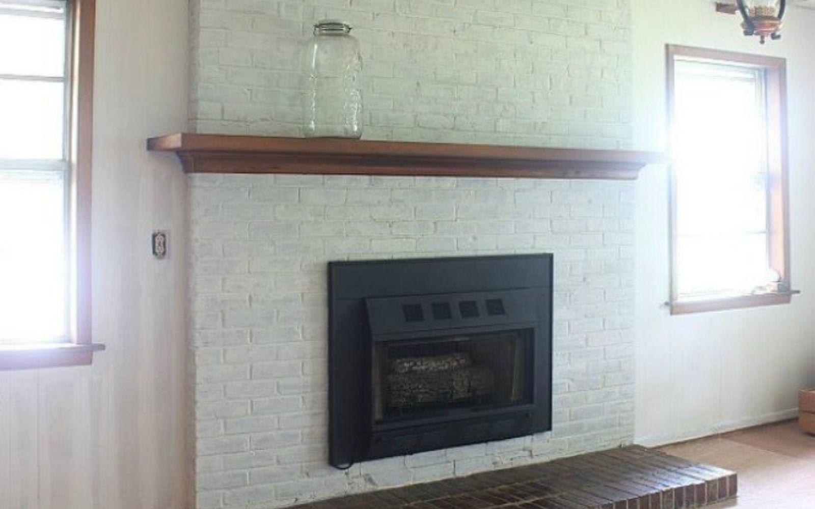s 10 gorgeous ways to transform a brick fireplace without replacing it, concrete masonry, fireplaces mantels, The fix Paint the brick a bright color