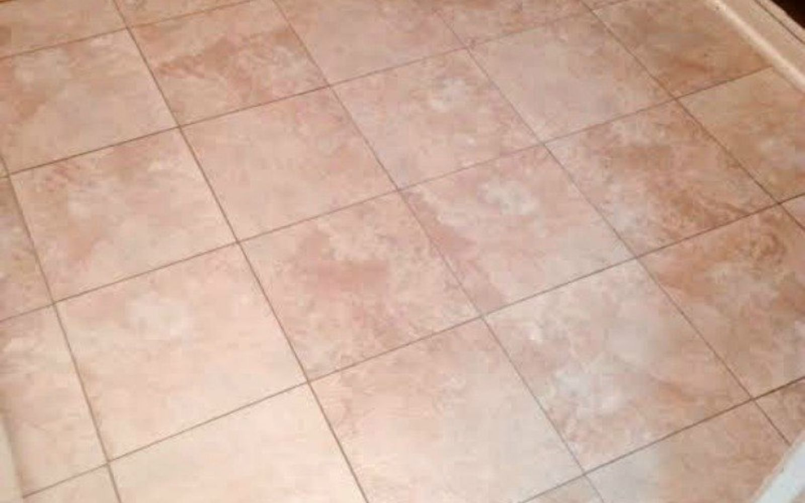 s shock your guests with these shoe string budget flooring ideas, flooring, Place some peel and stick high end tiles