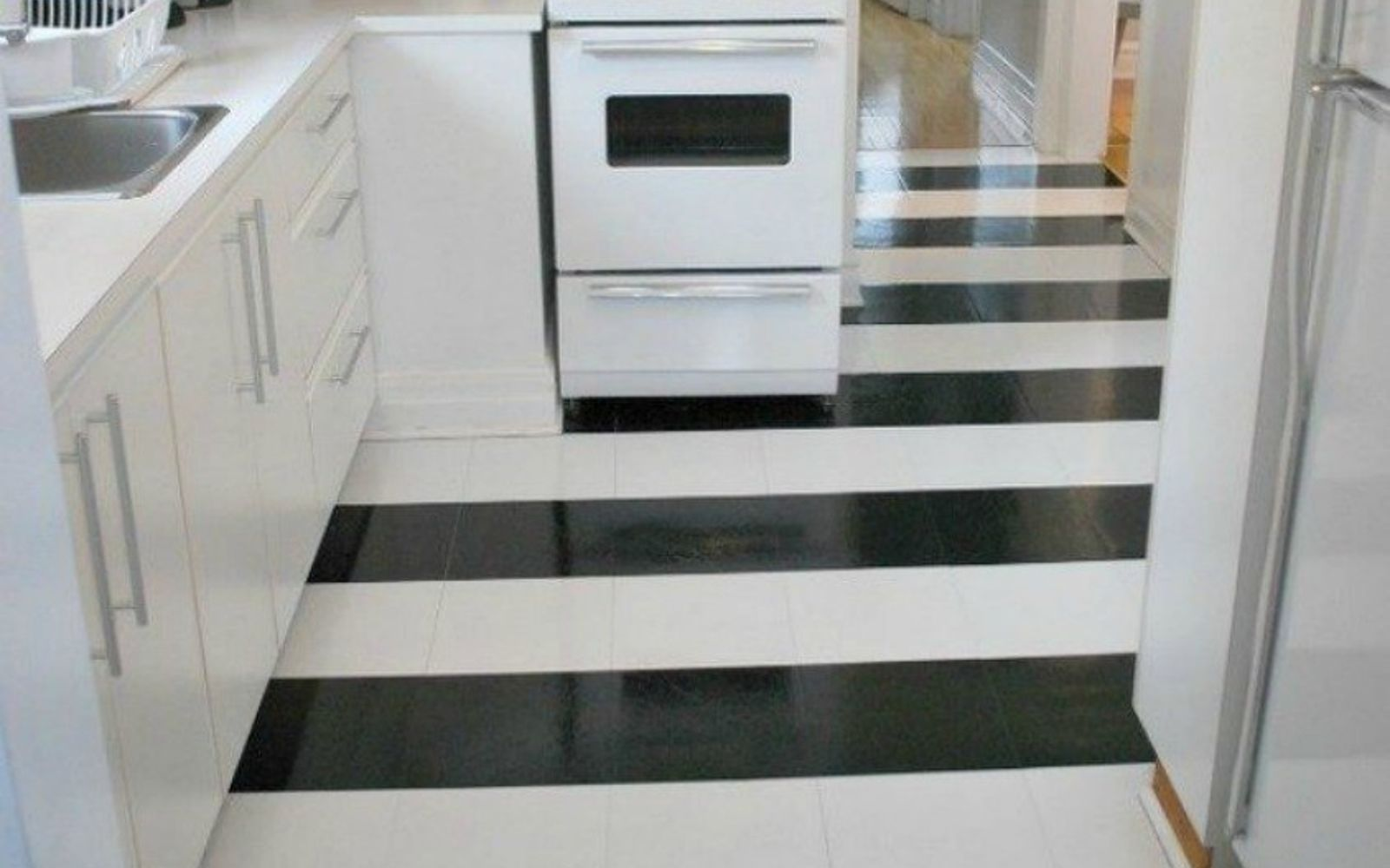 s shock your guests with these shoe string budget flooring ideas, flooring, Get a cool pattern with vinyl flooring