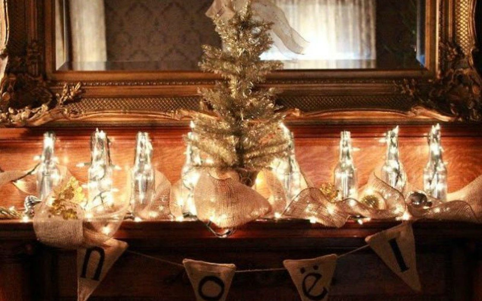 s hang your christmas lights in these 10 breathtaking spots, On your mantel in glowing bottles