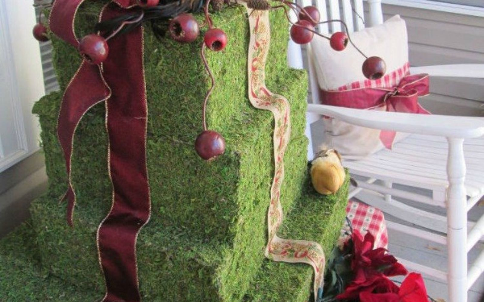 s cut up cardboard for these breathtaking christmas ideas, christmas decorations, Stack them into an outdoor present topiary