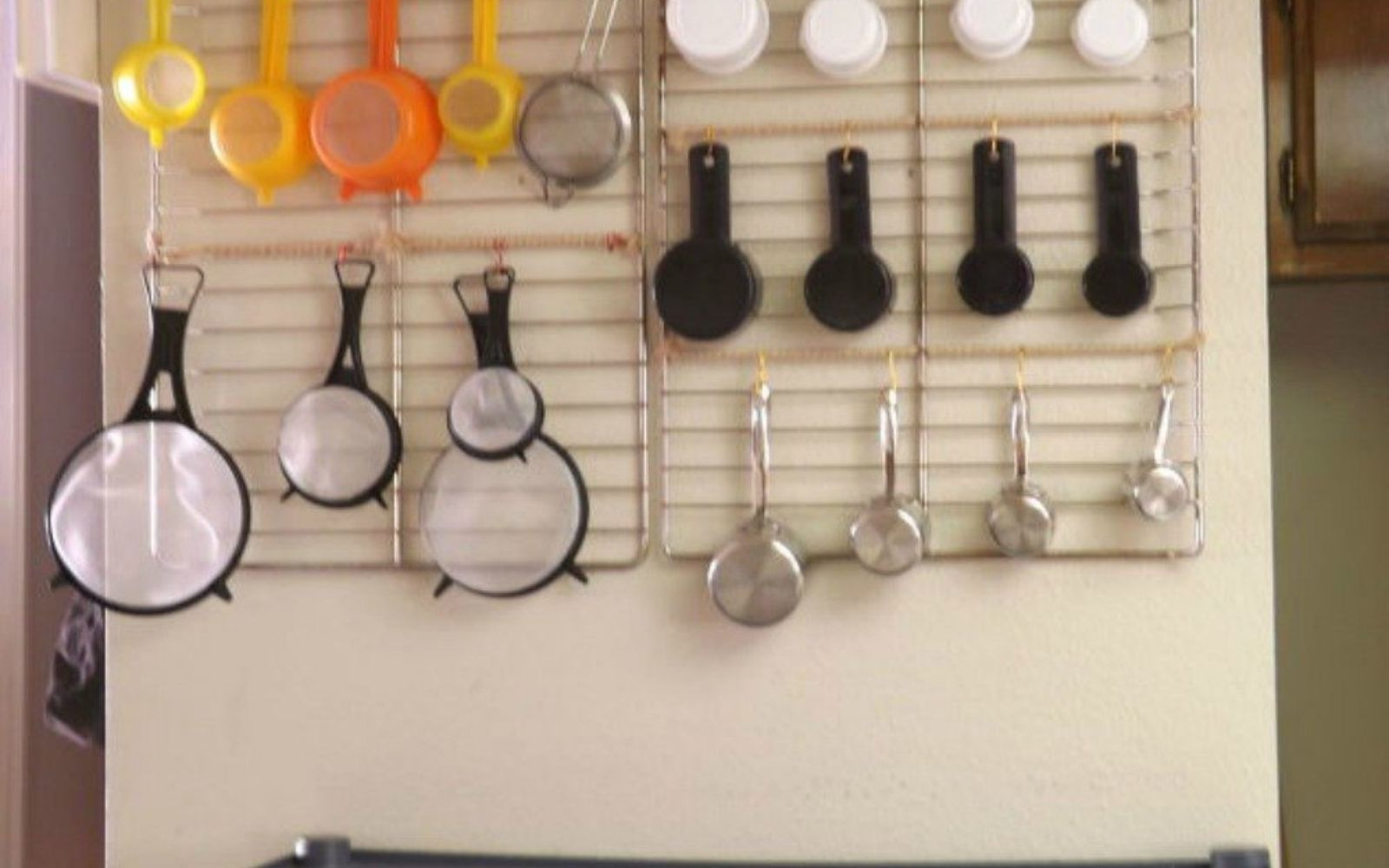 s 13 storage ideas that will instantly declutter your kitchen drawers, kitchen design, organizing, storage ideas, Or hang them on oven racks on your wall