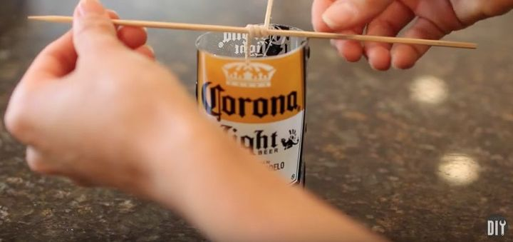 Diy beer bottle glass cutting candles hometalk for How to cut a beer bottle at home