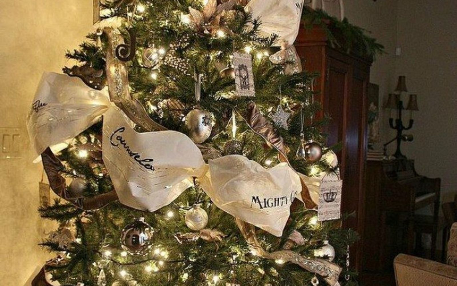 s don t stop at ornaments these tree decorating ideas are even better, christmas decorations, seasonal holiday decor, Wrap around paper ribbon for a fuller effect