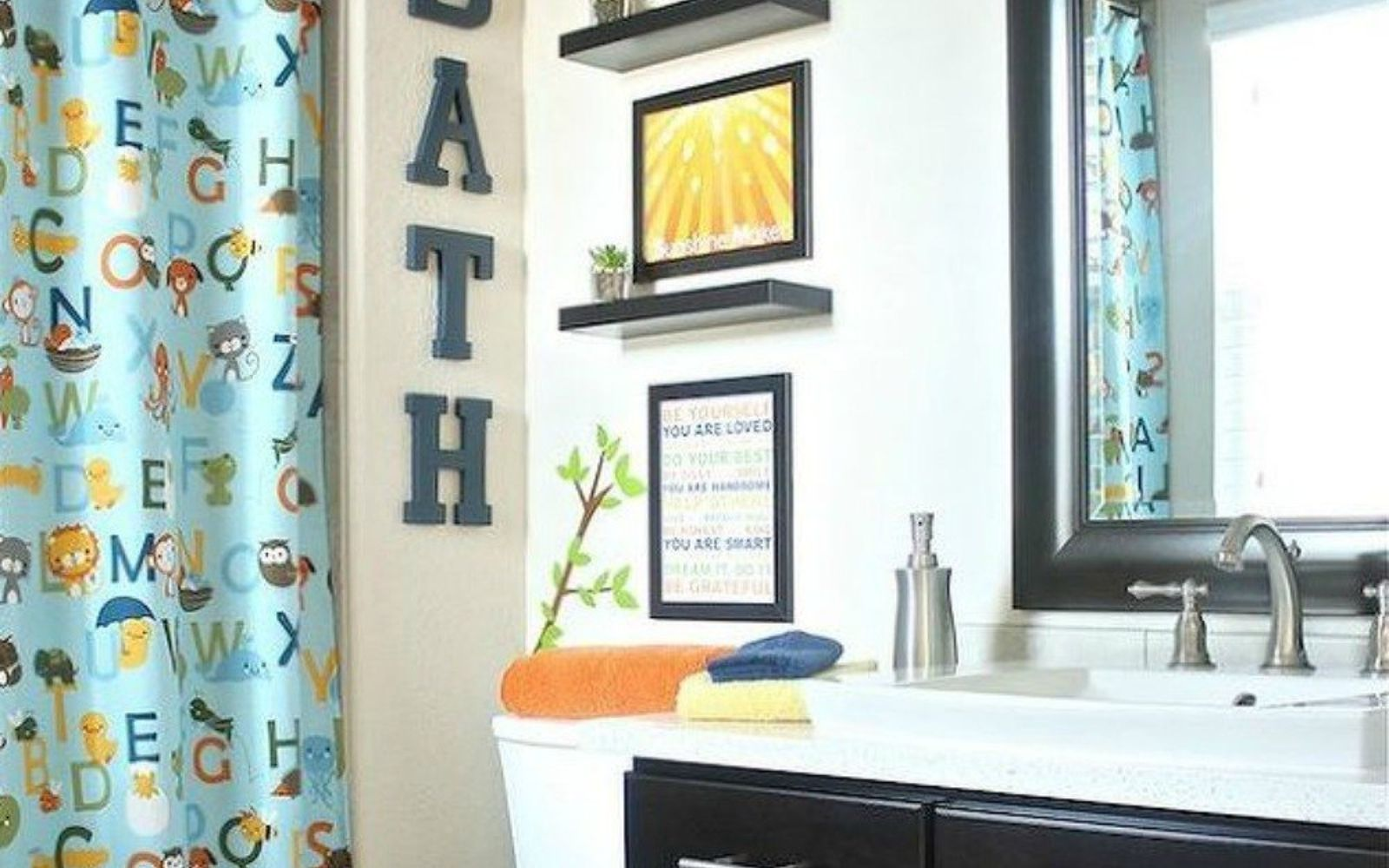 give your kids the coolest bathroom with these 13 jaw dropping stick decals on the walls to transport them