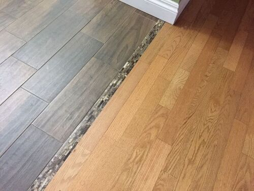 Transitioning hardwood floor to tile floor is there a for Tile and hardwood floor