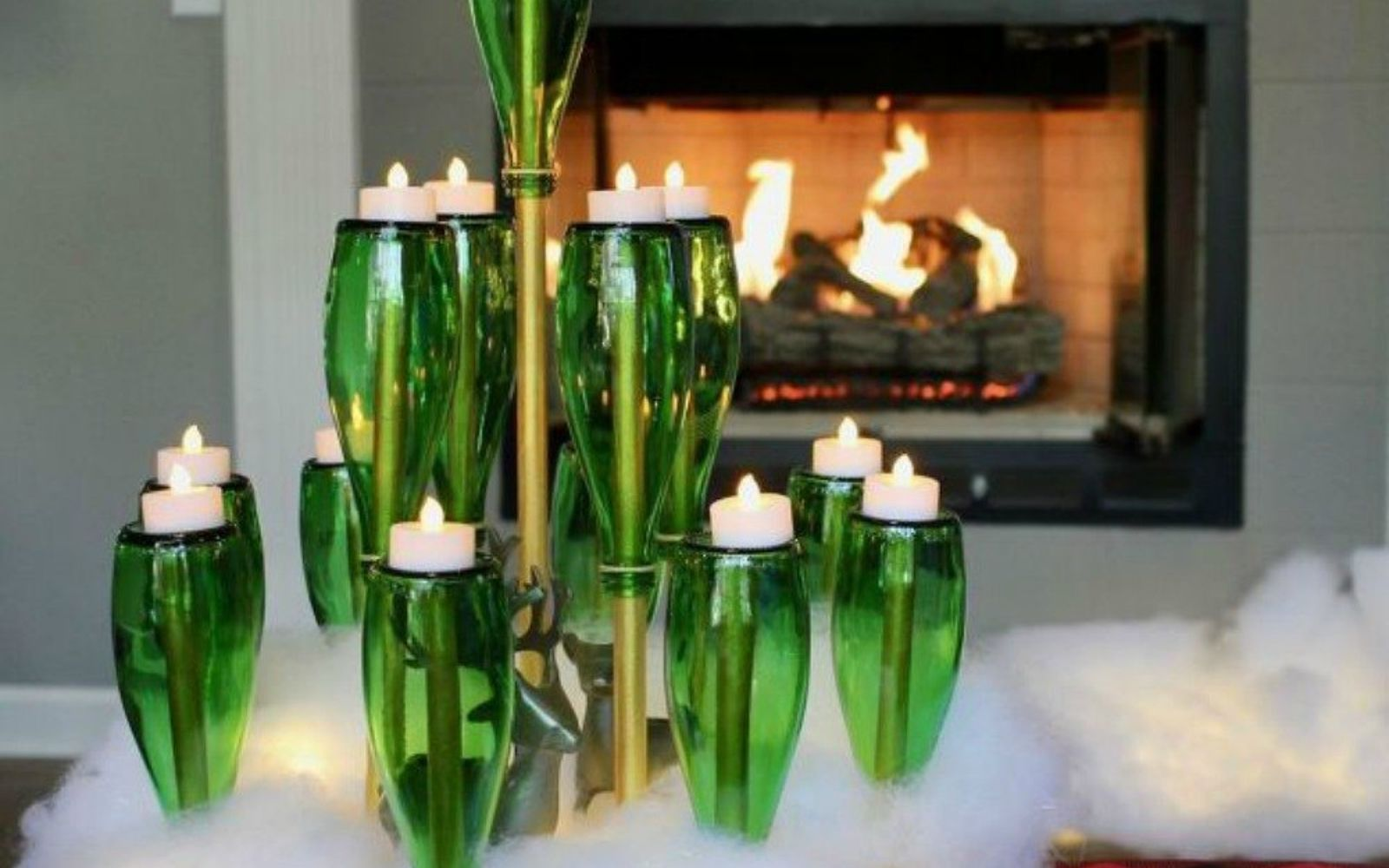 s forget your traditional christmas tree these are even better, Turn your green beer bottles upside down