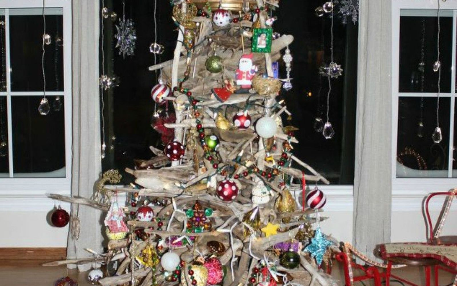 s forget your traditional christmas tree these are even better, Stack a pile of driftwood into a tree