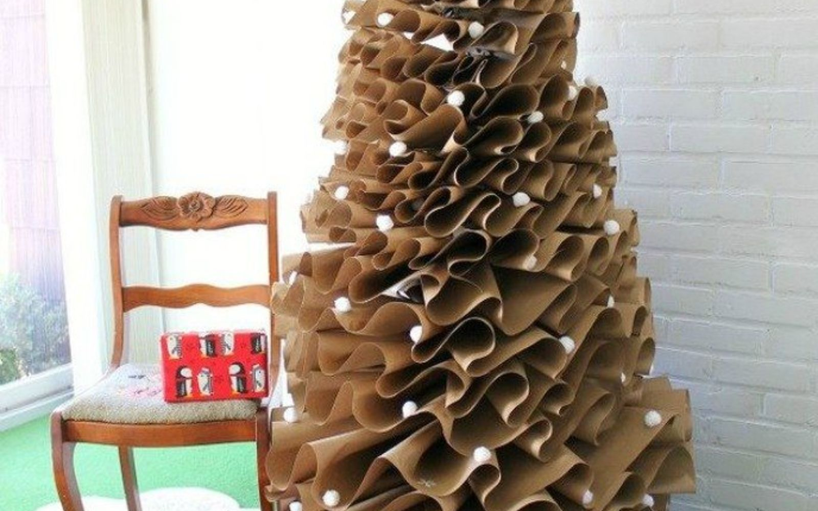 s forget your traditional christmas tree these are even better, Layer brown paper into a full size tree