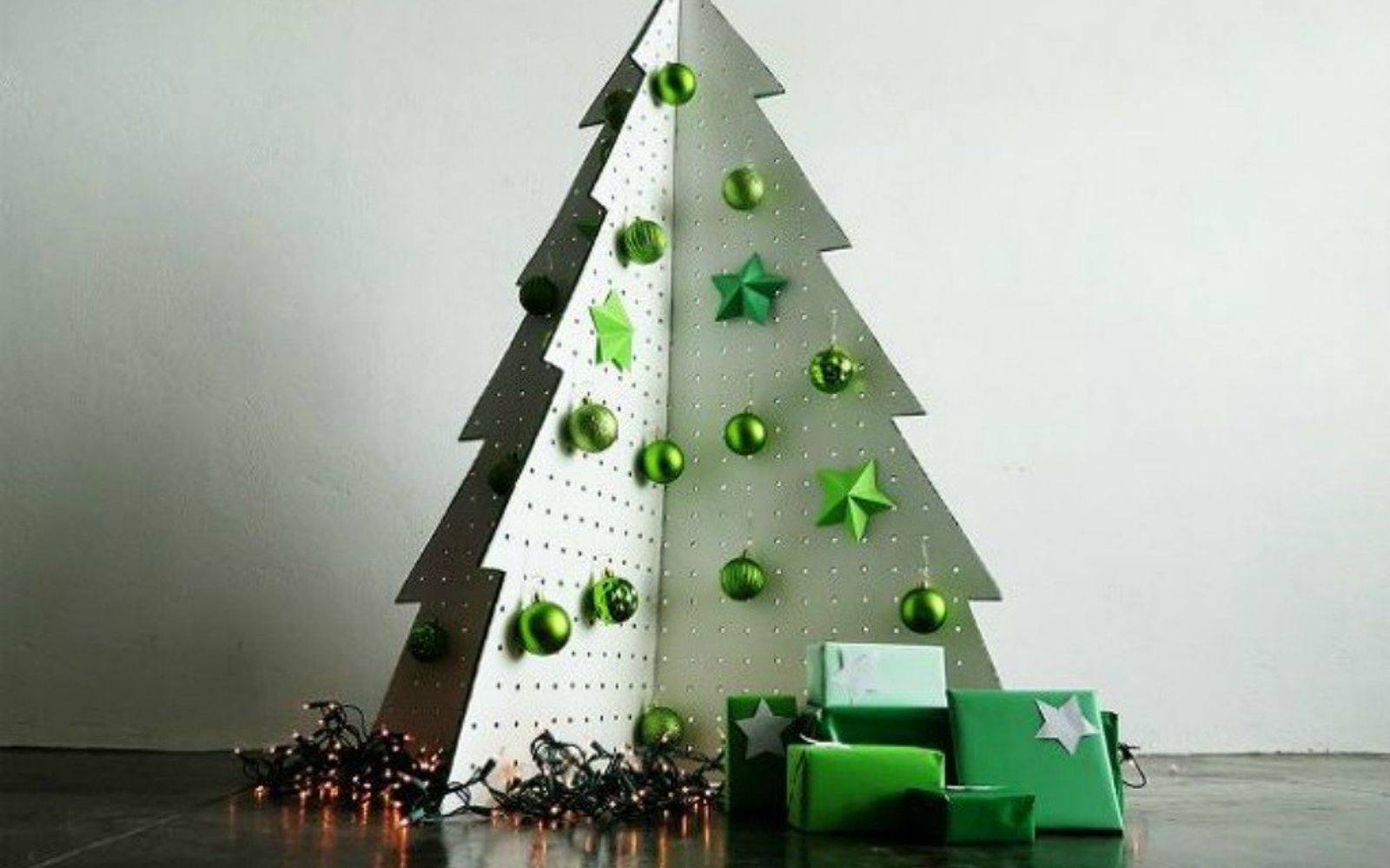 s forget your traditional christmas tree these are even better, Cut pegboard into an easily foldable tree