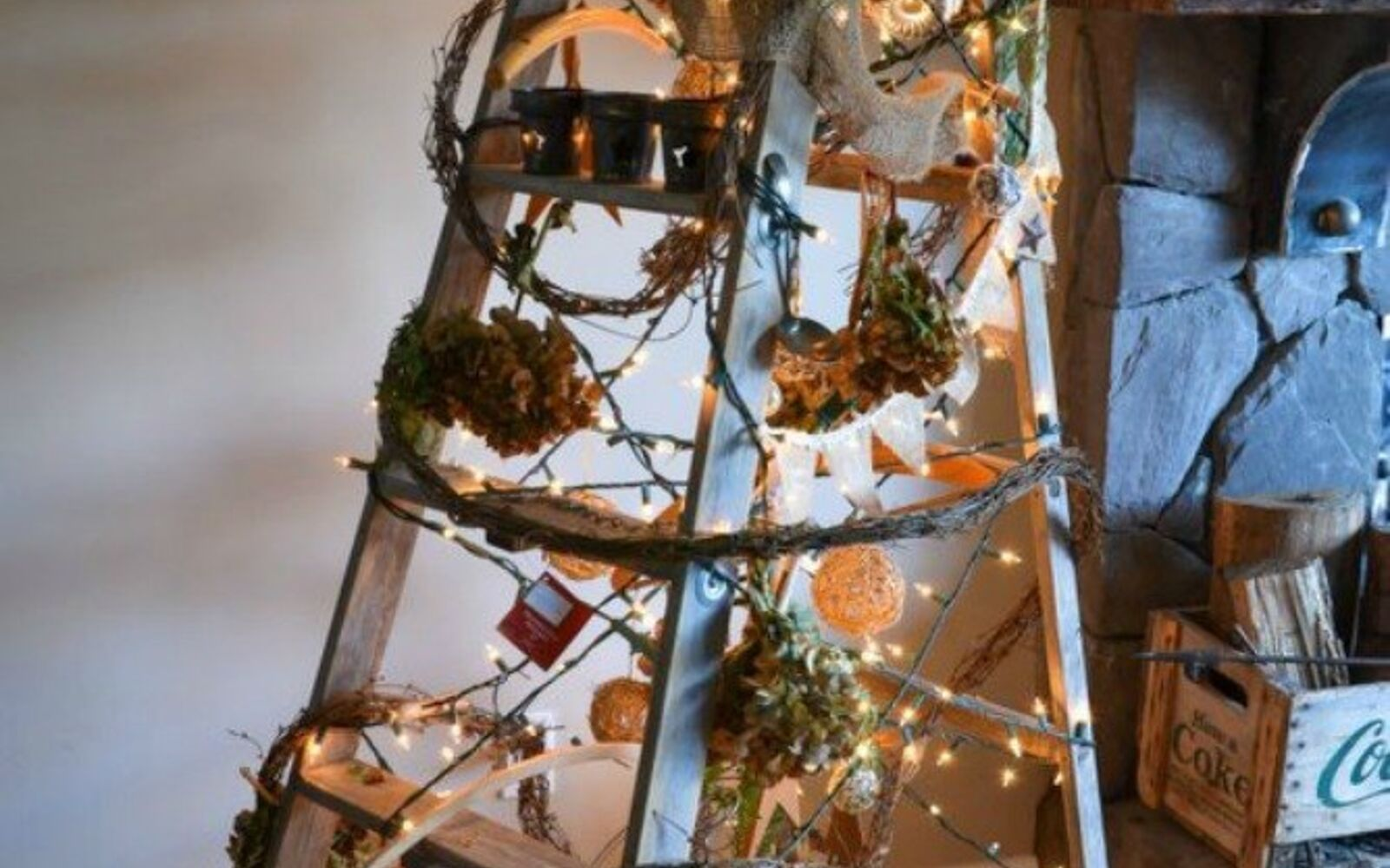 s forget your traditional christmas tree these are even better, Wrap ornaments and garland around a ladder