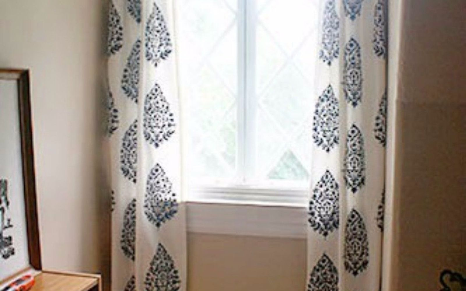 s decorate your living room for under 10 with these 15 ideas, Stencil a drop cloth for new curtains