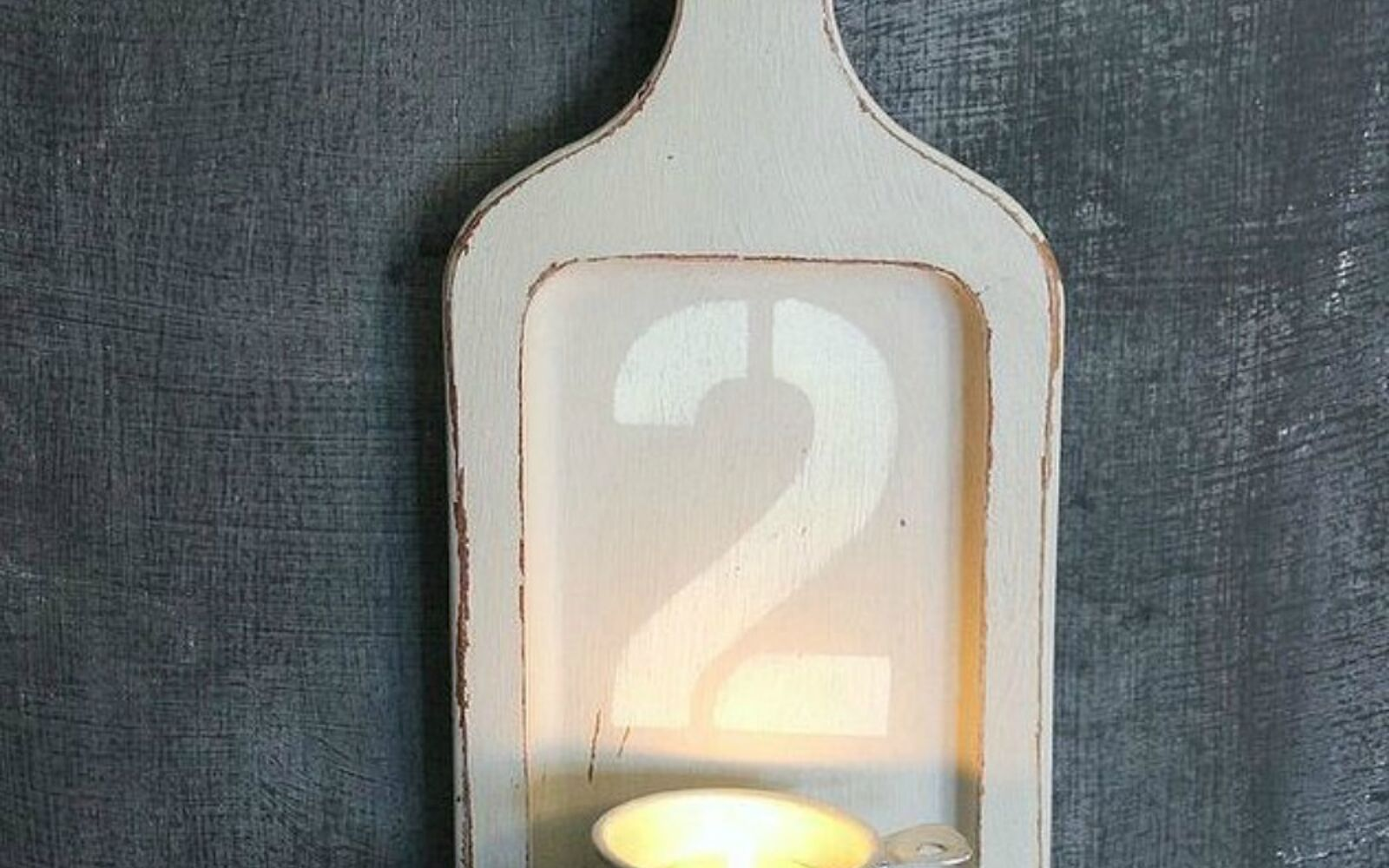 s 14 amazing things you can do with dollar store appetizer dishes, Flip a cheap loaf tray into a candle holder