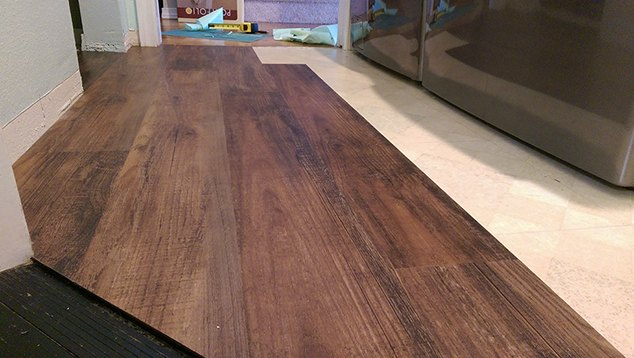 Transform your laundry room floor with faux wood vinyl for Fake wood linoleum