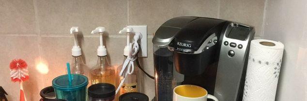 q mug cup display in a rental