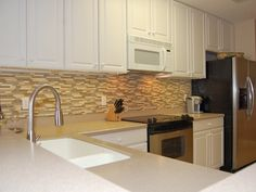 Here Is A Photo That I Found Of An Nice Tile Backsplash With Beige Corian Looks Great