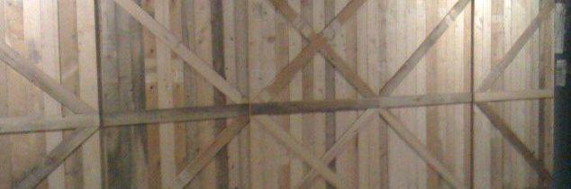 q rolling barn door made from scrap pallet wood, doors, outdoor living, pallet