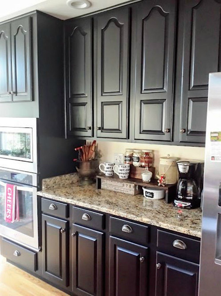 12 reasons not to paint your kitchen cabinets white hometalk for Black and white painted kitchen cabinets