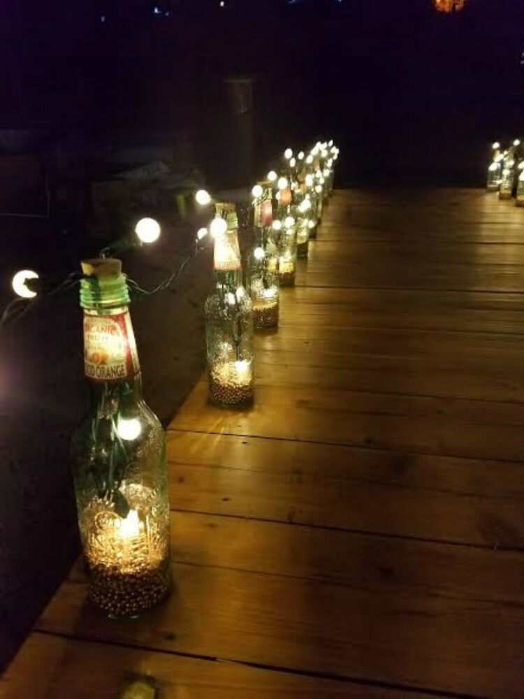 Drink up here 39 s 14 awesome things you can do with your for Empty bottle decoration ideas