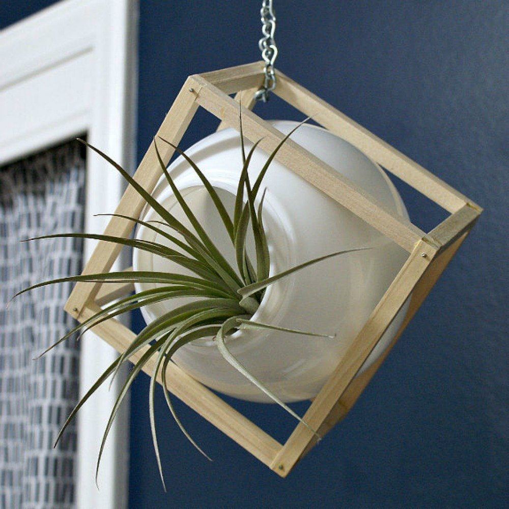 s 15 ways you never thought of using light fixtures in your home, home decor, Build a chic modern globe planter