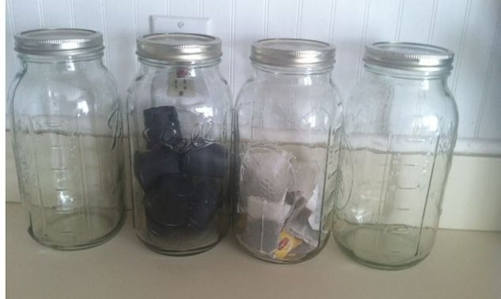 Get rid of kitchen countertop clutter with 13 clever mason for Kitchen jar ideas