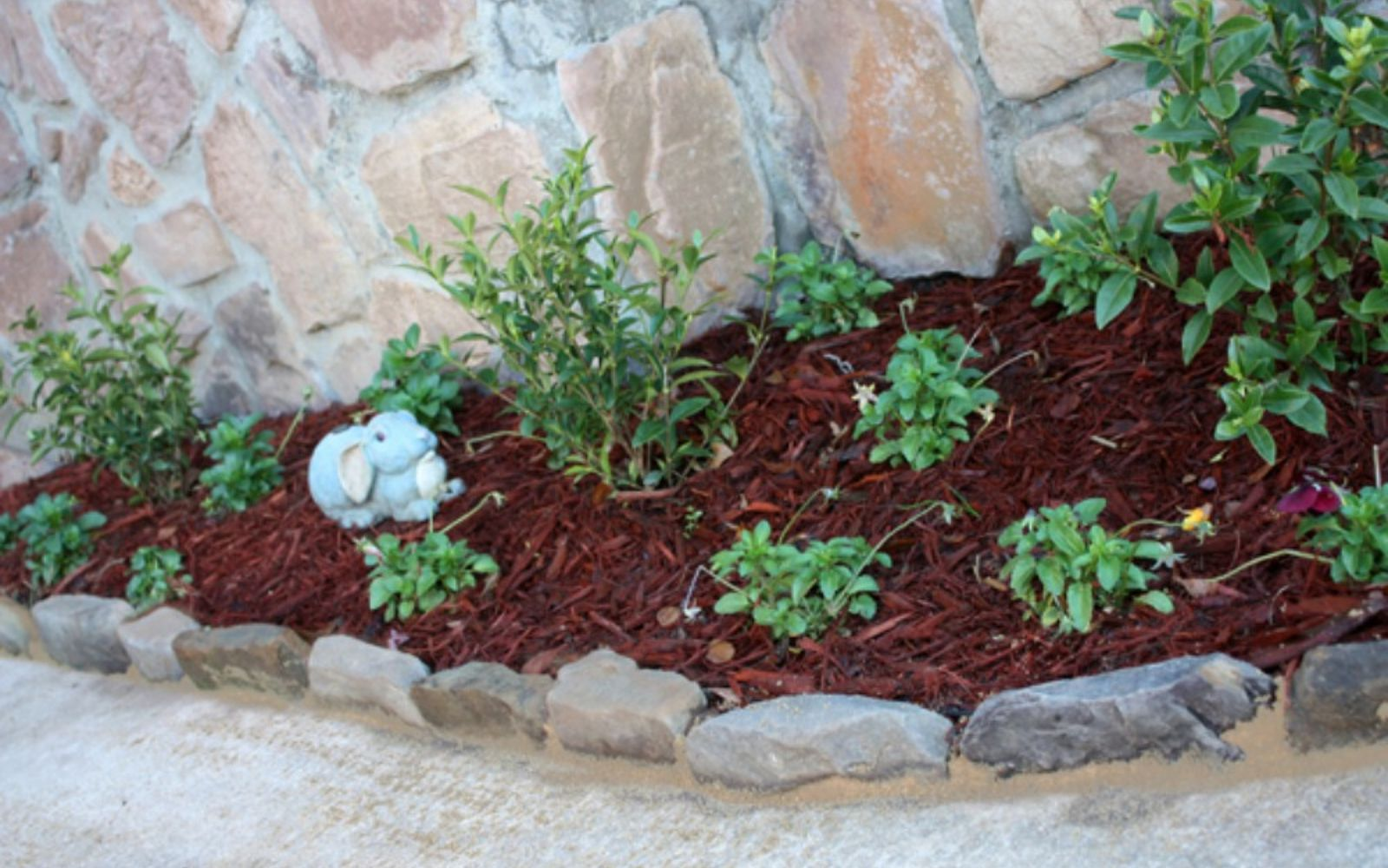 s 11 impressive ways to update your home with stone, concrete masonry, home decor, Create a pretty landscape edging