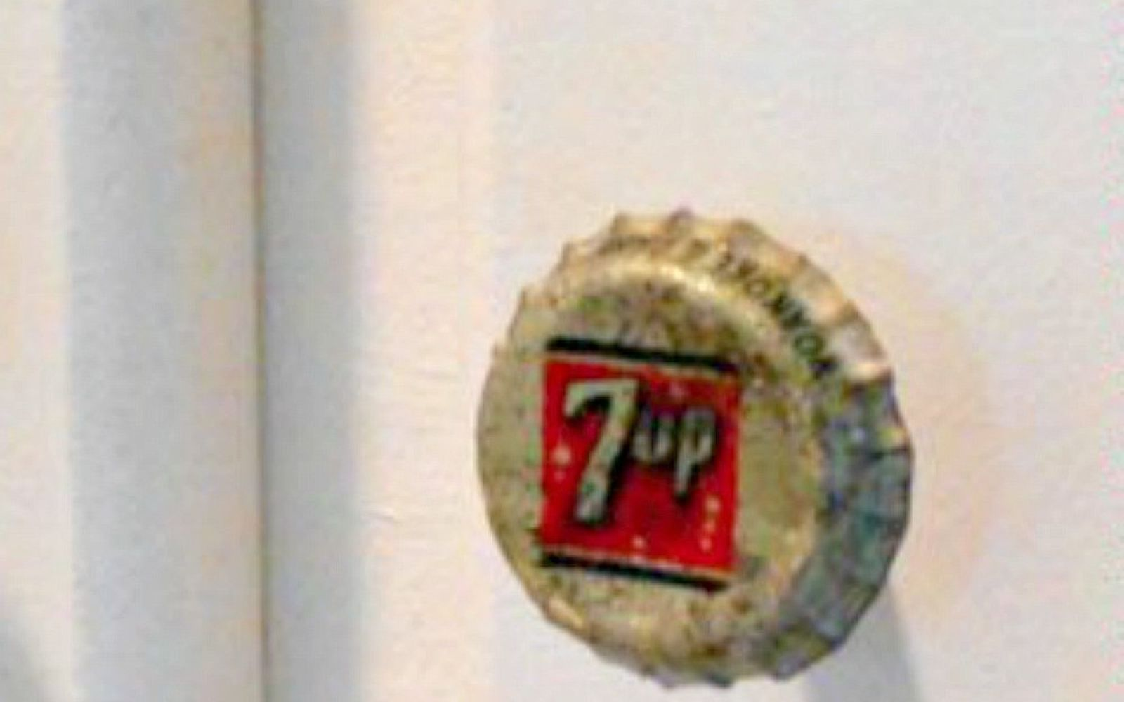 s save your bottle caps for these x crazy cool ideas, A vintage chic kitchen cabinet knob