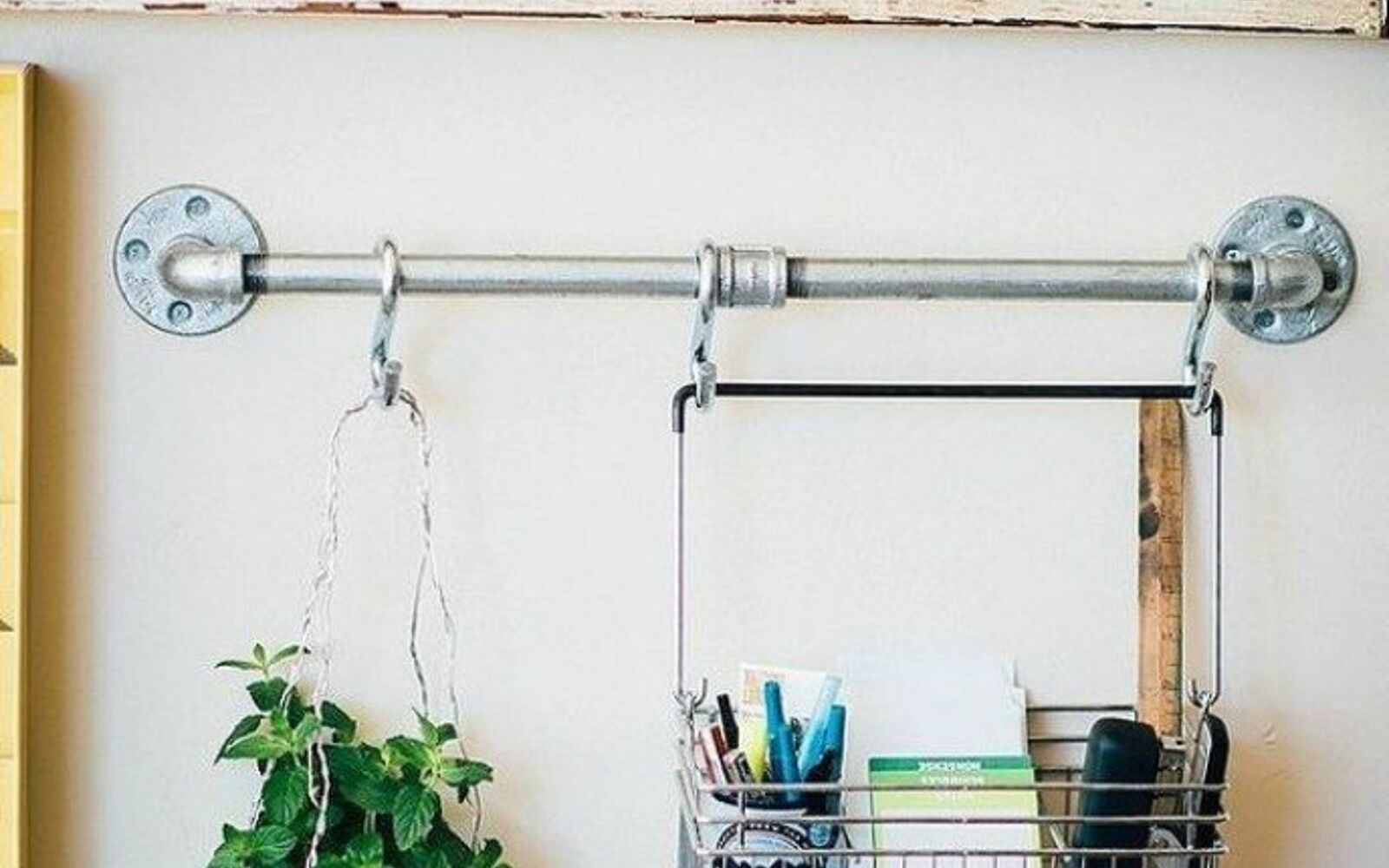 s the 15 coolest ways to reuse pipes in your home decor, Hang it on your wall as an organizer
