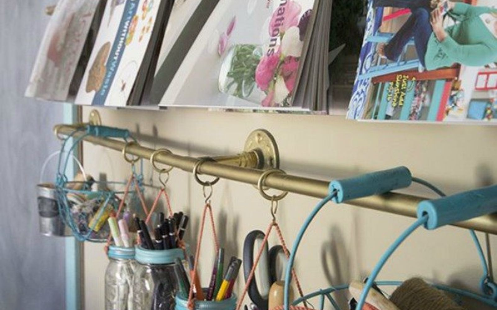 s the 15 coolest ways to reuse pipes in your home decor, Use industrial pipes as a storage rail system