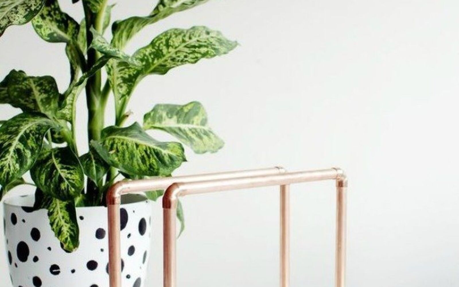 s the 15 coolest ways to reuse pipes in your home decor, Build them into a magazine rack