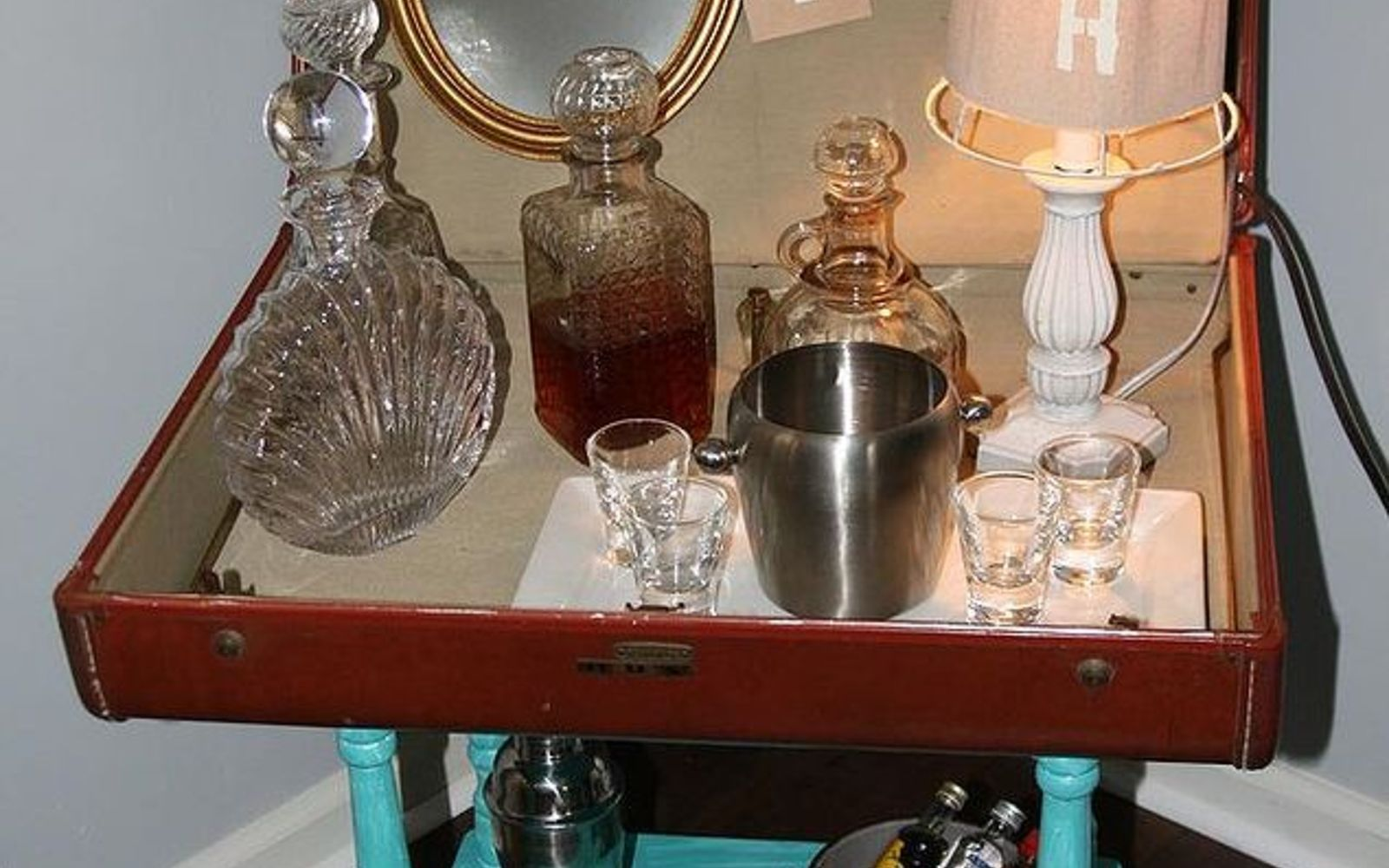 s don t throw out your old suitcase before you see these 15 clever ideas, Use it as a vintage bar