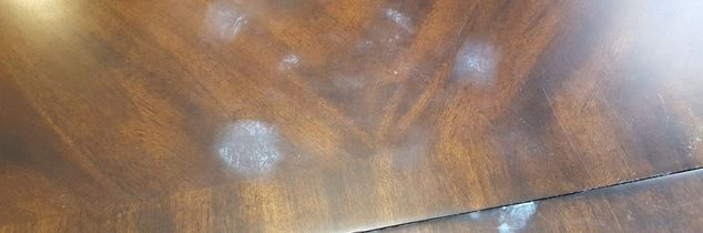 q white spots on breakfast room table