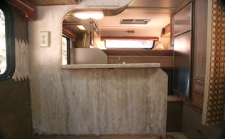 marbled walls and countertops in a difficult tiny space