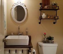 repurposed 100 yr old barn door to the bathroom