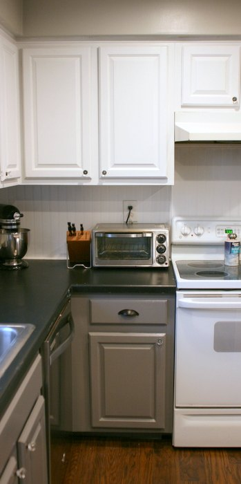 Tuxedo kitchen spray painted cabinet makeover hometalk for Cost to spray kitchen cabinets