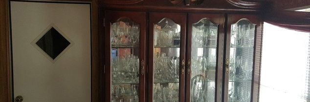 q any ideas for use of top half of glass door china cabinet